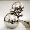 Mirror stainless steel sphere sculpture